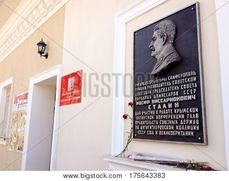 SIMFEROPOL CRIMEA UKRAINE - FEB 28 2017: Memorial plaque in honor of Stalin on main office of Comunist Party of Russian Federation CPRF in Simferopol Crimea Ukraine on Feb 28 2017.