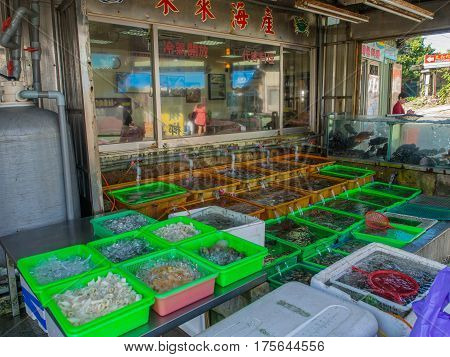 Fuji Taiwan - October 03 2016: Various fresh fish shells and other sea creatures in containers on a stall on a fish market