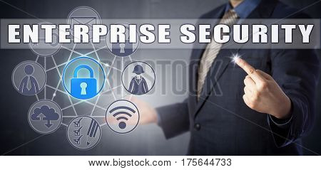 Business manager in blue suit is highlighting an ENTERPRISE SECURITY scenario. Information technology metaphor and business challenge concept for enterprise architecture and application security.