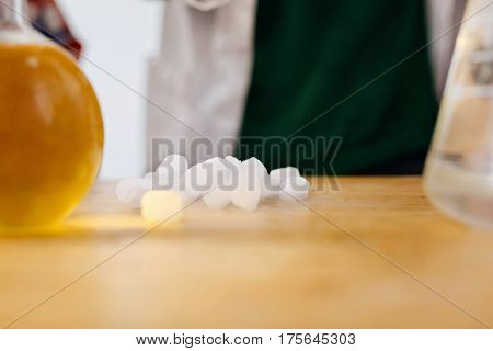 Chemical lab. Close up of some chemicals lying on the table while being ready be used for a chemical experiment