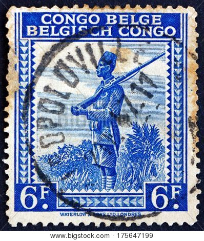 BELGIAN CONGO - CIRCA 1942: a stamp printed in Belgian Congo shows Askari local soldier serving in the army of the European colonial power in Africa circa 1942