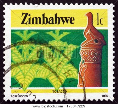 ZIMBABWE - CIRCA 1985: a stamp printed in Zimbabwe shows Zimbabwe bird and tobacco agriculture circa 1985