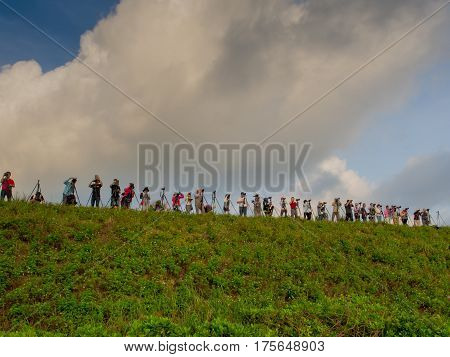 Fuji Taiwan - October 03 2016: A dozen of photographers with camera waiting for the sunset over the ocean on the northern coast of Taiwan