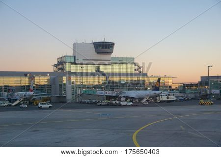 FRANKFURT, GERMANY - JAN 20th, 2017: Aircrafts, an Airbus from Lufthansa, at the gate in Terminal 1 at Frankfurt International Airport FRA during sunset. Terminal 1 was completed in 1972 and houses Lufthansa and other Star Alliance partners.