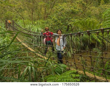 Shifen Taiwan - October 05 2016: Rope bridge over a river in the mountains near Shiften