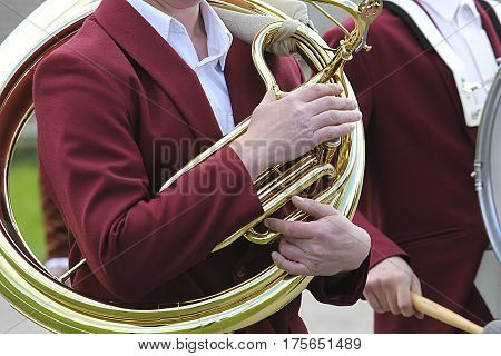 Musician Is Playing On The Golden Tuba