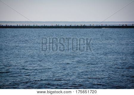 Anglers standing on the pier and catching fish