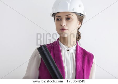 Serious Woman Worker In White Safety Helmet