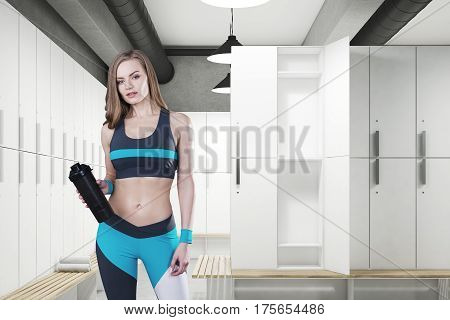 Woman with a yoga mat in a locker room with gray walls a row of wooden storage lockers near the wall and a bench with rolled towels on it. 3d rendering. Mock up.
