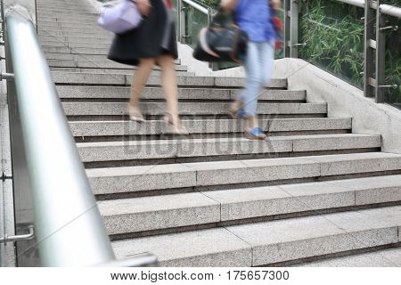 Young adult  walking Down the stairs