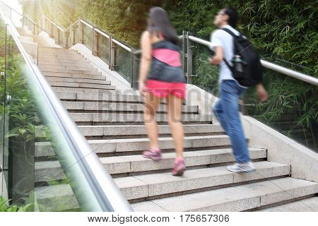 Young adult  walking up the stairs