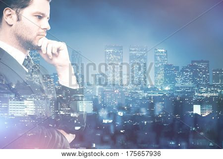 Side view of thoiughtful young businessman on cit background with copy space. Double exposure. Employment concept