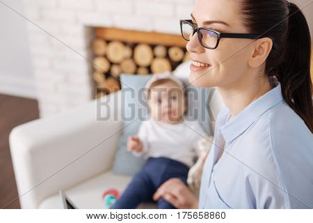 I can do it. Competent classy beautiful woman using her maternity leave profitably working from home and still taking care of her child