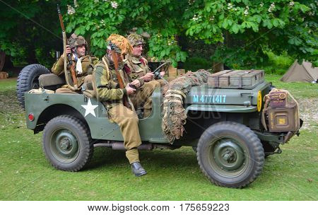 SILSOE, BEDFORDSHIRE, ENGLAND - MAY 30, 2016: World War 2 Jeep with men dressed as World War 2 American Soldiers.