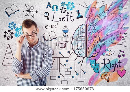 Thoughtful european man on concrete background with mathematical formulas and colorful sketch. Creative and analytical thinking concept