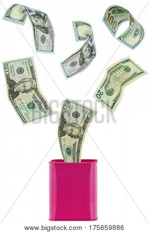 Many USD dollar banknote money flying in to or out of pink metal piggybank, saving can isolated on white