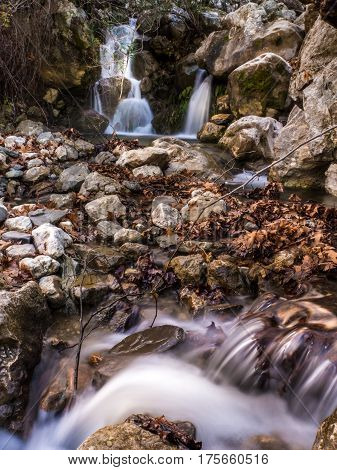 the beautiful waterfall in deep forest taken by long exposure