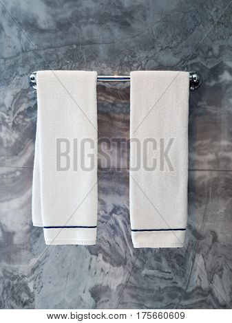 Two Clean white towels hanging on hanger