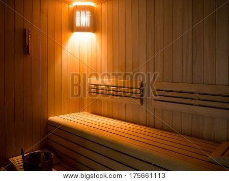 Luxury Sauna room with traditional sauna accessories