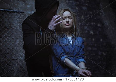 Gonna hurt you bad. Angry brutal crazy man saying terrible things to his victim making her being afraid of him