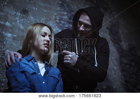 You have anything to say. Antagonized wicked crooked man pointing a gun at the womans head why trying getting some information from her