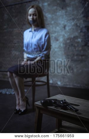 Why me. Clueless anxious business lady being captured for ransom while sitting on a chair and being tied up