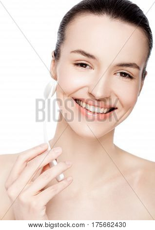 Beautiful girl holding drainage massage face roller on white background