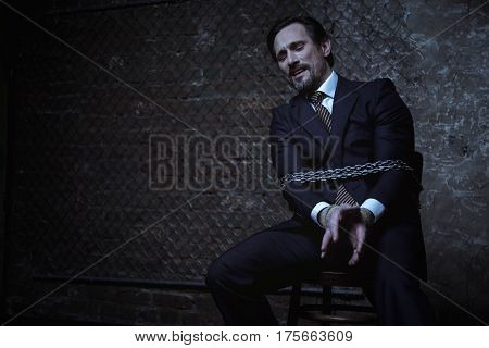 Just not in the face. Scared pathetic rich gentleman talking to his kidnapper begging for mercy while being chained up to a chair