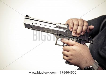 A teenage male holding a gun / Gun violence in school concept