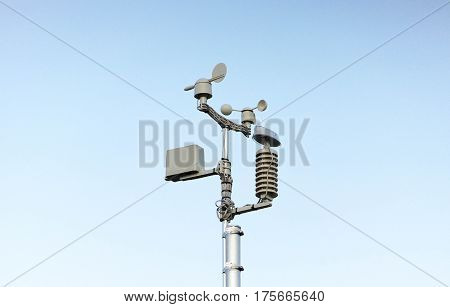 A Weather station on blue sky background