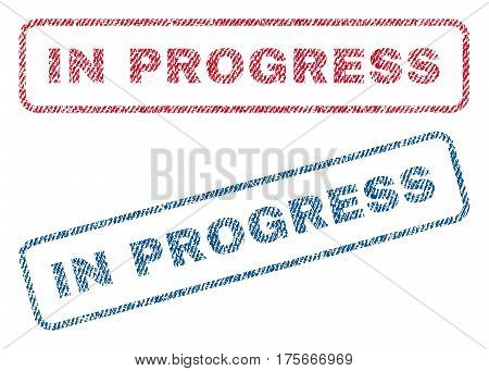 In Progress text textile seal stamp watermarks. Blue, red fabric vectorized texture. Vector tag inside rounded rectangular banner. Rubber sign with fiber textile structure.