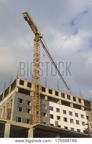 Building and Construction Concepts. Construction Building Site With Industrial Mid-Size Crane.Vertical Image Composition