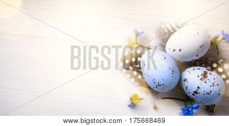 Happy Easter day; Holidays background with Easter eggs and spring flowers on table