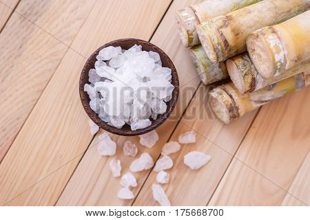 Rock Sugar And Sugar Cane On Wooden Table Background