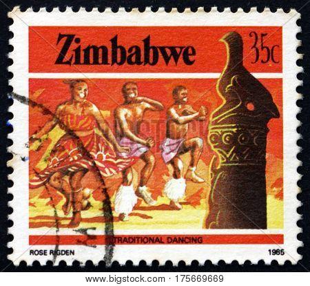 ZIMBABWE - CIRCA 1985: a stamp printed in Zimbabwe shows Zimbabwe bird and traditional dancing heritage circa 1985