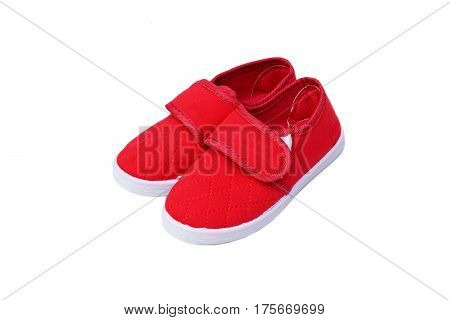 Red slip on shoes isolated on white