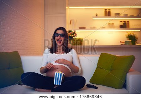 Pregnant Woman Watching Thrilling Movie At Home Alone