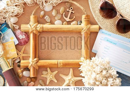Travel concept. Composition of marine symbols and blank bamboo frame on textured background