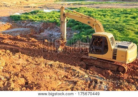 Old Excavator Working In Construction Site