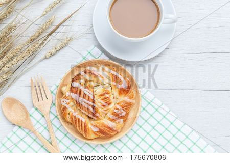 Top View Danish Pastries And Coffee Cup On White Wooden Table
