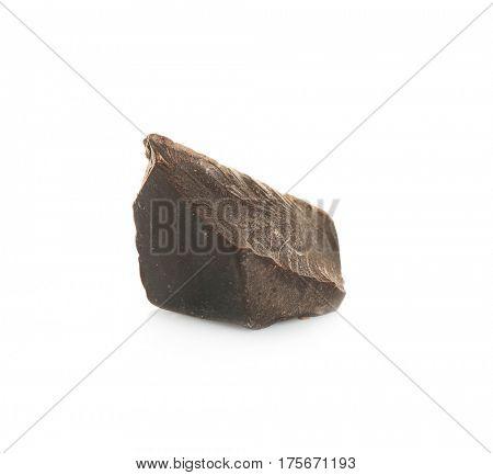 Dark chocolate morsel on white background