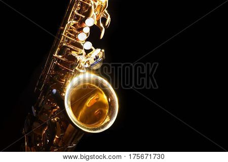 low key alto saxophone and light in the dark background