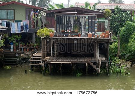 Slum Thai house near river or canal