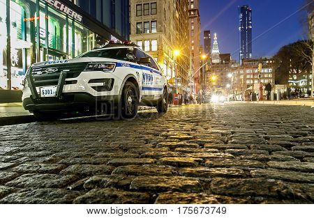 New York March 8 2017: An NYPD vehicle is parked on cobblestone street on Union Square in Manhattan.