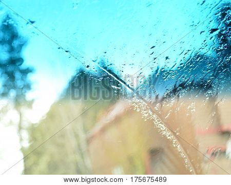 car windshield on a rainy cloudy day