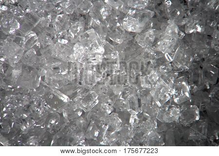 Microscopic sugar transparent crystals. Food background texture. Super macro close-up by microscope