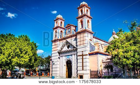 Beautiful photo of the parish of San Francisco de Asis, with blue sky background accompanied by beautiful green trees