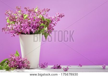 Lilac bouquet on purple background