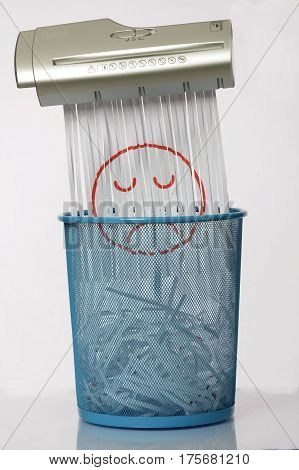 Paper shredders and paper drawn with blue recycle bin, for waste paper collection.