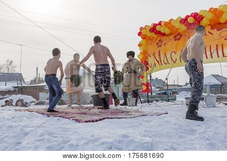 Berdsk Novosibirsk oblast Siberia Russia - February 26 2017: Russian holiday of farewell to winter. View Siberian bath hardening in the cold with birch twigs